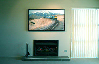 The original, 'TranzAlpine Journey' by Grant McSherry is a large size oil painting, finished in a hand crafted, black lacquer shadow frame with negative space.